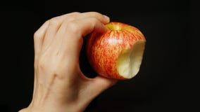 Apple rouge sur le fond noir Images stock