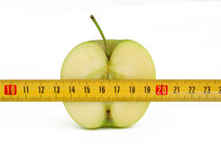 Apple and roulette. Half green apple with yellow roulette royalty free stock image