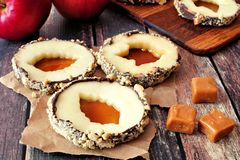 Apple rounds with caramel filled leaf centers, over rustic wood Stock Images