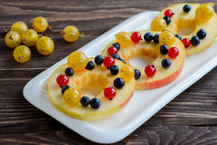 Apple rounds cut with honey and berries Stock Photography
