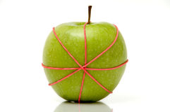 Apple in rubber band 2 royalty free stock photo