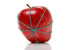 Apple in rubber band royalty free stock photo