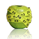 Apple with ruler Stock Images