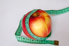 Apple with a ruler Royalty Free Stock Images