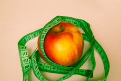 Apple with a ruler Stock Image