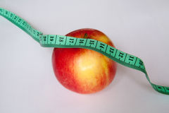Apple with a ruler Royalty Free Stock Image