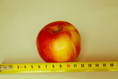 Apple with a ruler Stock Photo