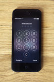 Apple 5 or 5s enter passcode screen on wood Stock Image