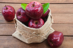 Apple sack. On wooden table royalty free stock photography
