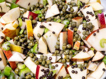 Apple salad with capers and leaf celery Royalty Free Stock Photo