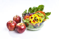 Apple and salad. Healthy care with apple salad and cherry tomatoes snack Royalty Free Stock Photo