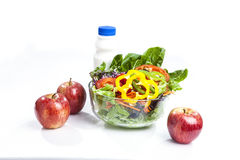 Apple and salad milk. Healthy care with milk apple salad and cherry tomatoes snack Stock Image