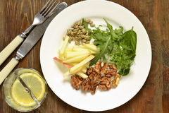 Apple salad with walnuts, pumpkin seeds and arugula Royalty Free Stock Photography