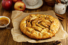 Apple and salted caramel galette. Apple and salted caramel rustic galette, free form pie stock image