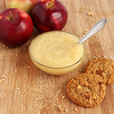Apple sauce. With oatmeal cookies and red apples Royalty Free Stock Photos