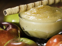 Apple sauce with rolled wafer Royalty Free Stock Images