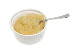 Apple sauce and spoon Stock Image