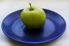 Apple on a saucer stock image