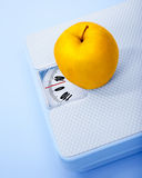 Apple on scale Stock Photo