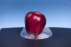 Apple on a scale. Stock Photography