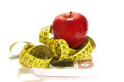 Apple and scale. Red apple, scale and tape measure isolared Stock Images