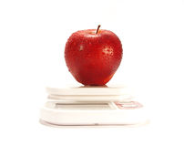 Apple and scale isolated. Red apple and scale isolared on white background Stock Photo
