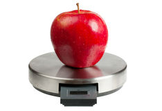 Apple on a scales Stock Photos
