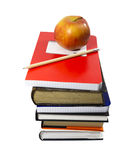 Apple and school essentials (with clipping path). Concept of grade school education depicting an apple.  Clipping path included Stock Photo