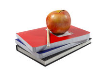 Apple and school essentials (with clipping path). Concept of grade school education depicting an apple.  Clipping path included Royalty Free Stock Photography