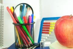 Apple by school items Stock Photos