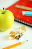 Apple and school supplies royalty free stock image