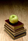 Apple and school textbooks. Green apple on pile of school books Royalty Free Stock Photos