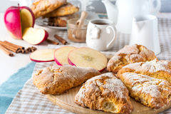 Apple scones for breakfast with apple cider glaze. Royalty Free Stock Photo