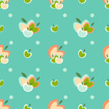 Apple seamless vector pattern. Seamless vector pattern with apples and polka dots Stock Image
