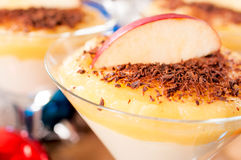 Apple in semolina pudding. Close up to the sliceof red apple in semolina pudding Royalty Free Stock Images
