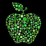 Apple shape. Vector illustration of  apple shape made up a lot of  green small flowers and leaf on the black background Royalty Free Stock Image