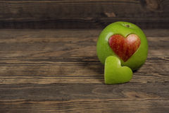 Apple in the shape of a heart Royalty Free Stock Image