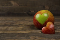 Apple in the shape of a heart Royalty Free Stock Photos
