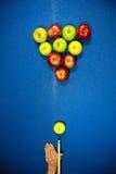Apple shaped billard balls. And billard cue on the billard table Stock Photography