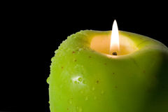 Apple-shaped candle Stock Photo