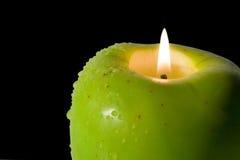 Apple-shaped candle Stock Photo