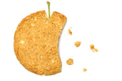 Apple shaped cookie with crumbs Royalty Free Stock Photo