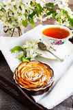 Apple shaped roses pie and cup of tea on the serving tray Royalty Free Stock Images