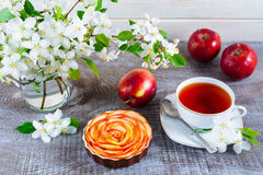 Apple shaped roses pie and cup of tea on wooden table Royalty Free Stock Photography