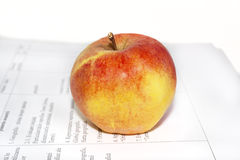 Apple on a sheet of paper Stock Image