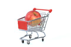 Apple in shopping basket Stock Photo