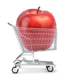 Apple in shopping cart Royalty Free Stock Images