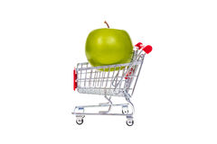 Apple in shopping cart isolated on white background Stock Photos