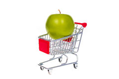 Apple in shopping cart isolated on white background Royalty Free Stock Photo