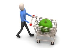 Apple in shopping trolley Stock Images
